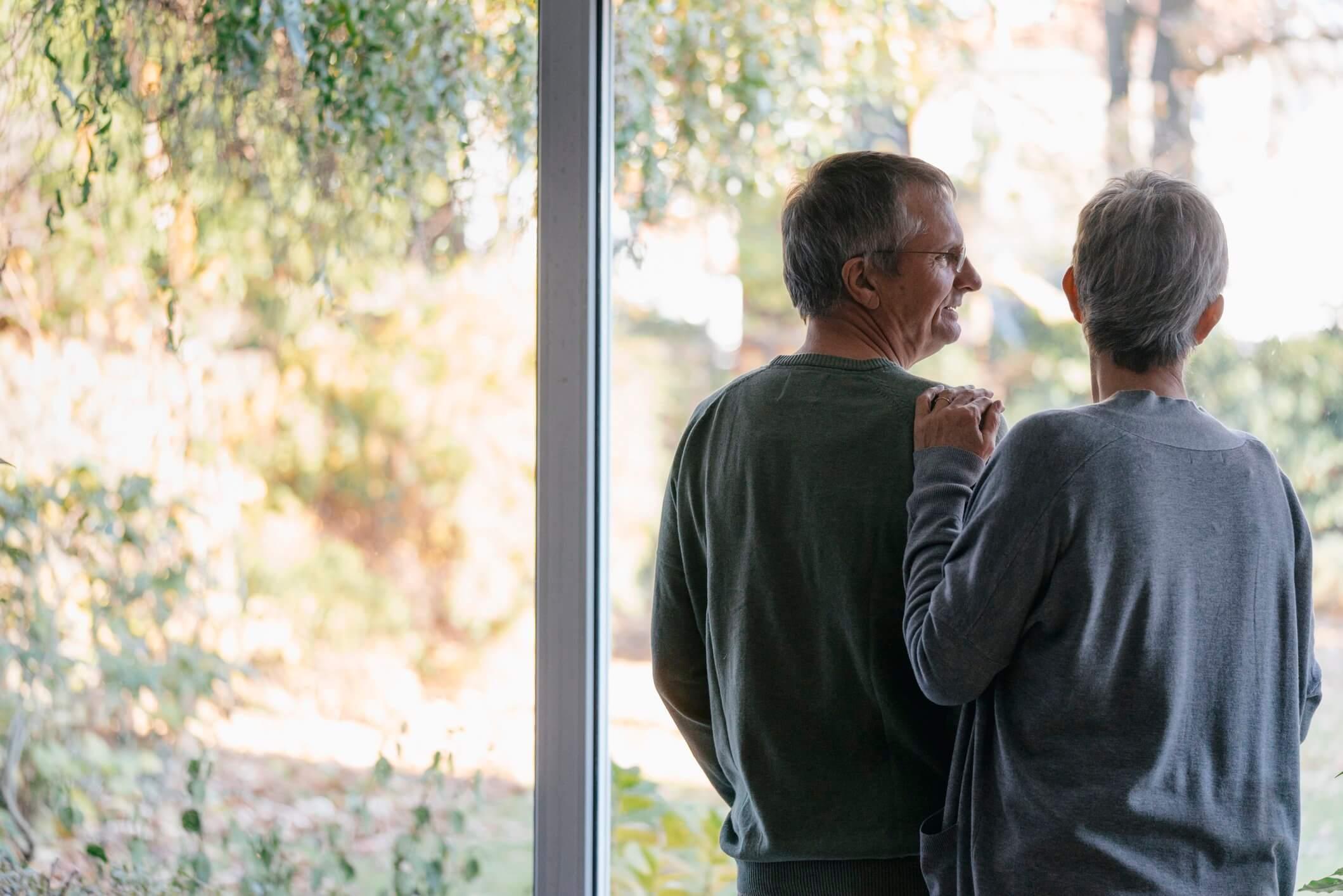 two elders watching the scene outside