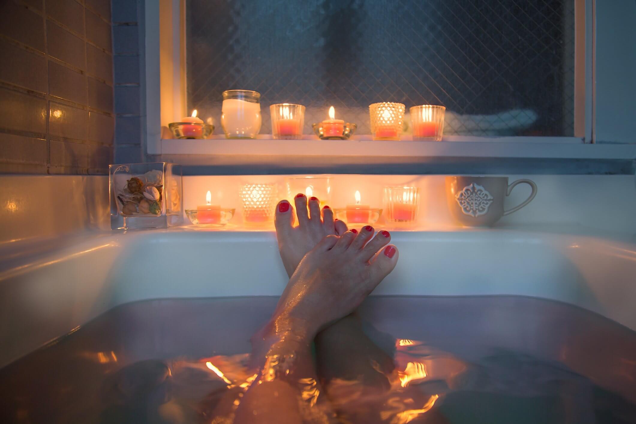 feet of the woman inside the bathtub