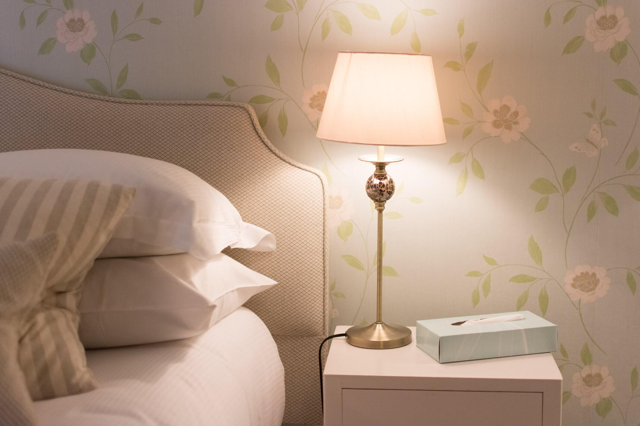 a lamp beside the bed
