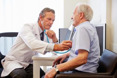 senior patient having medical exam