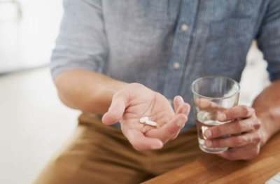 male drinks medicine